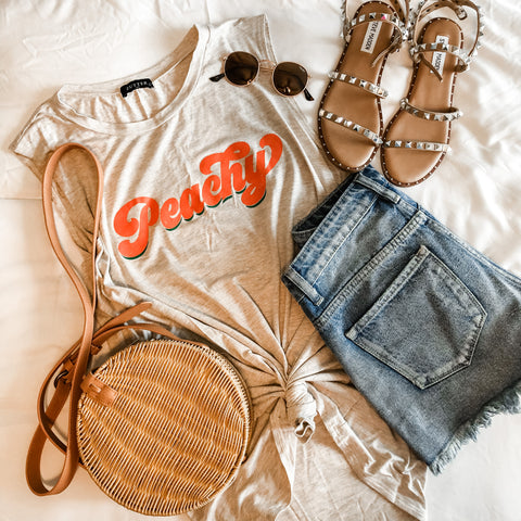 peachy graphic tee with denim shorts and steve madden shoes