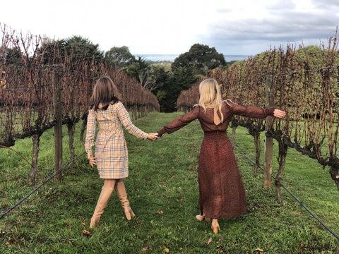women in vintage style clothes explore orchard and winery