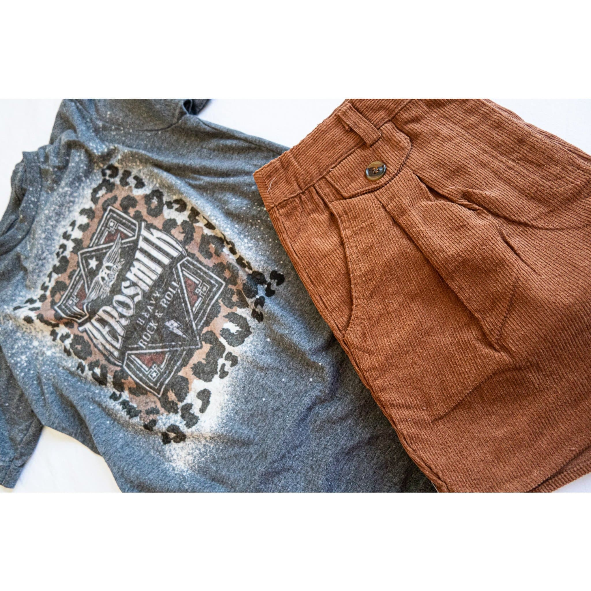 aerosmith graphic band tee paired with back in time burnt orange corduroy shorts for women. trendy casual boutique clothing for women