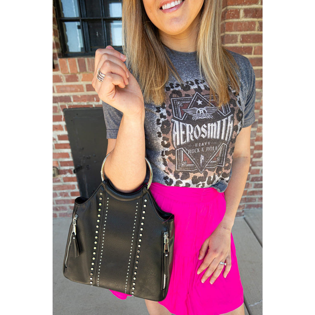 aerosmith bleached graphic tee and lizzie hot pink ruffled mini skirt by pink note paired with a black vegan leather rock n roll bag