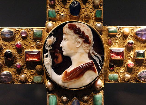 Cross of Lothair with Augustus cameo. The intersection of the cross is accented by a magnificent, three-layered sardonyx cameo. The slightly oval, antique cameo shows the turned to the left bust crowned with a laurel wreath of Emperor Augustus, who holds an eagle scepter in his right hand.