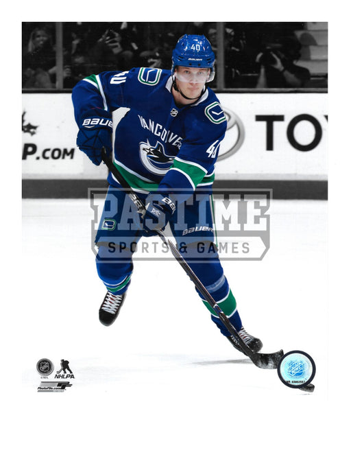 Elias Pettersson 8X10 Vancouver Canucks Home Jersey (Skating With Puck) - Pastime Sports & Games