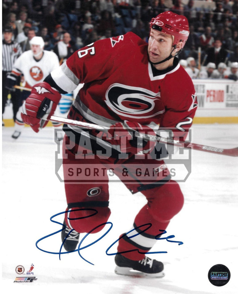 Eric Cole Autographed 8X10 Carolin Hurricains Home Jersey (Skating) - Pastime Sports & Games