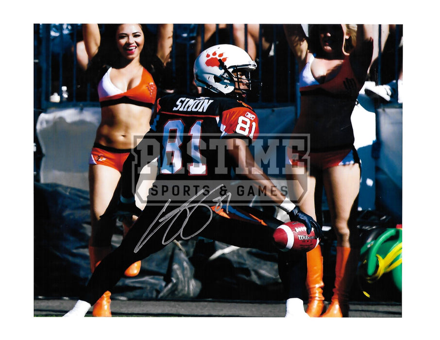 Geroy Simon Autographed 8X10 B.C Lions Home Jersey (Holding Ball Close Up) - Pastime Sports & Games