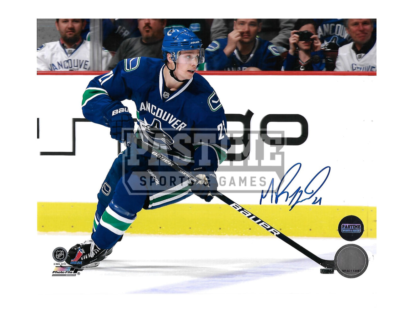 Mason Raymond Autographed 8X10 Home Jersey (Skating With Puck) - Pastime Sports & Games