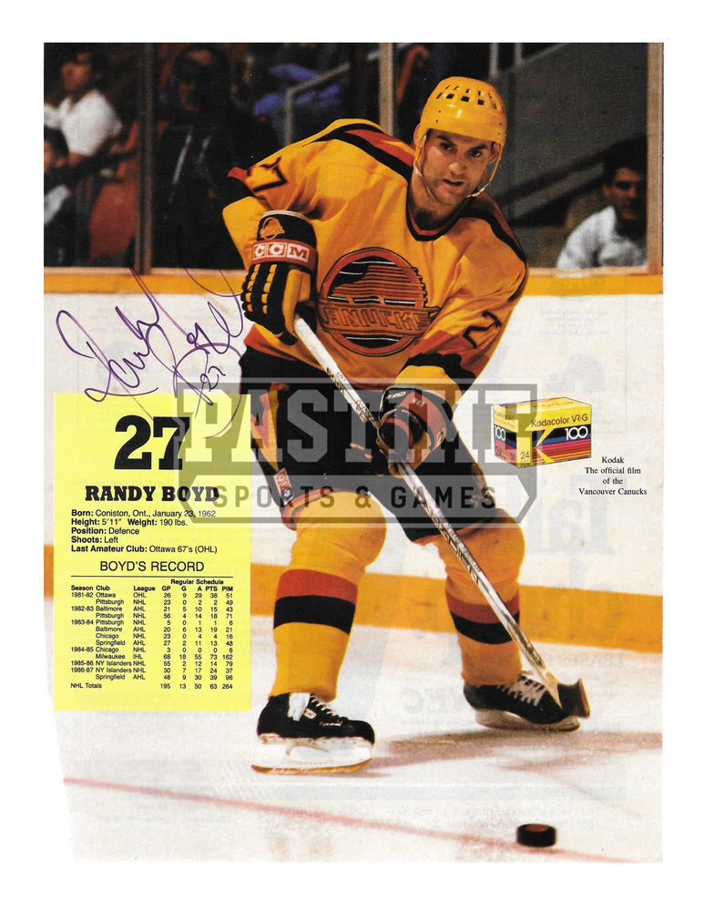 Randy Boyd Autographed 8X10 Magazine Page Vancouver Canucks Away Skate Jersey (With Puck) - Pastime Sports & Games
