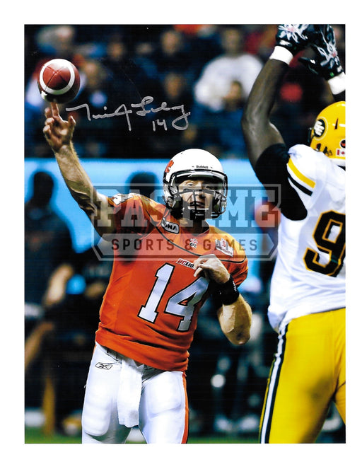 Travis Lulay Autogrpahed 8X10 B.C Lions Home Jersey (Throwing Ball) - Pastime Sports & Games