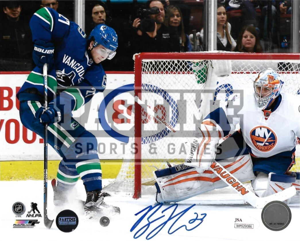 Ben Hutton Autographed 8X10 Vancouver Canucks Home Orca Jersey (About To Shoot) - Pastime Sports & Games
