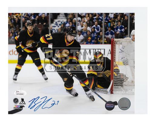 Ben Hutton Autographed 8X10 Vancouver Canucks Home Jersey (With Puck) - Pastime Sports & Games
