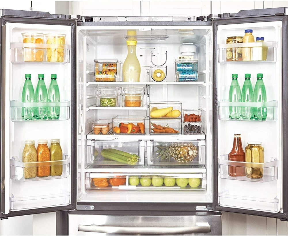 storing similar items together in the fridge is a simple way to stay organised. clear fridge containers are a great way to do this.