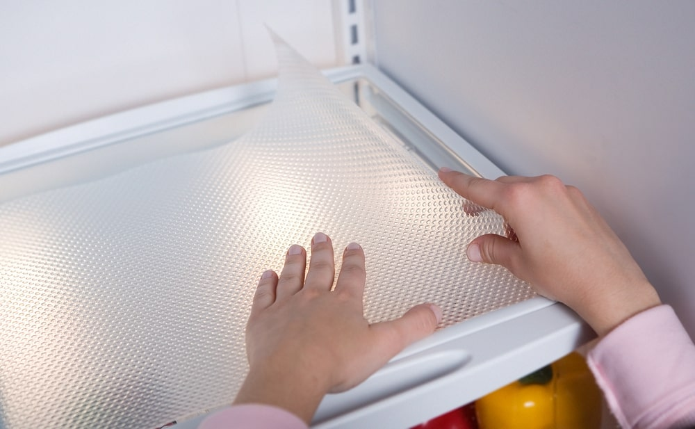 use a god quality fridge shelf liner to keep your fridge clean and organised