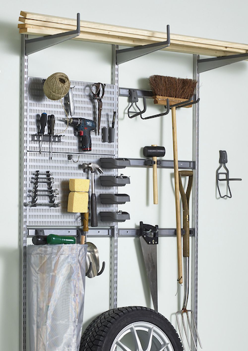 Gardening tools stored with Elfa shelving
