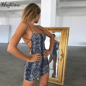 Hugcitar backless hollow out sexy bodycon dresses 2018 autumn women fashion club snakeskin print mini club dress