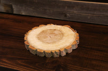 Load image into Gallery viewer, Gorgeous handcrafted solid wood modern live edge bark charger. Made in the U.S.A. these chargers are very classy and elegant. Sure to be a conversation piece in any home or cabin. Use these chargers to place plates on to complete your dining table. Not only do they look beautiful but they offer protection from water, food, heat and moisture that could potentially ruin the finish on a table or other piece of furniture.