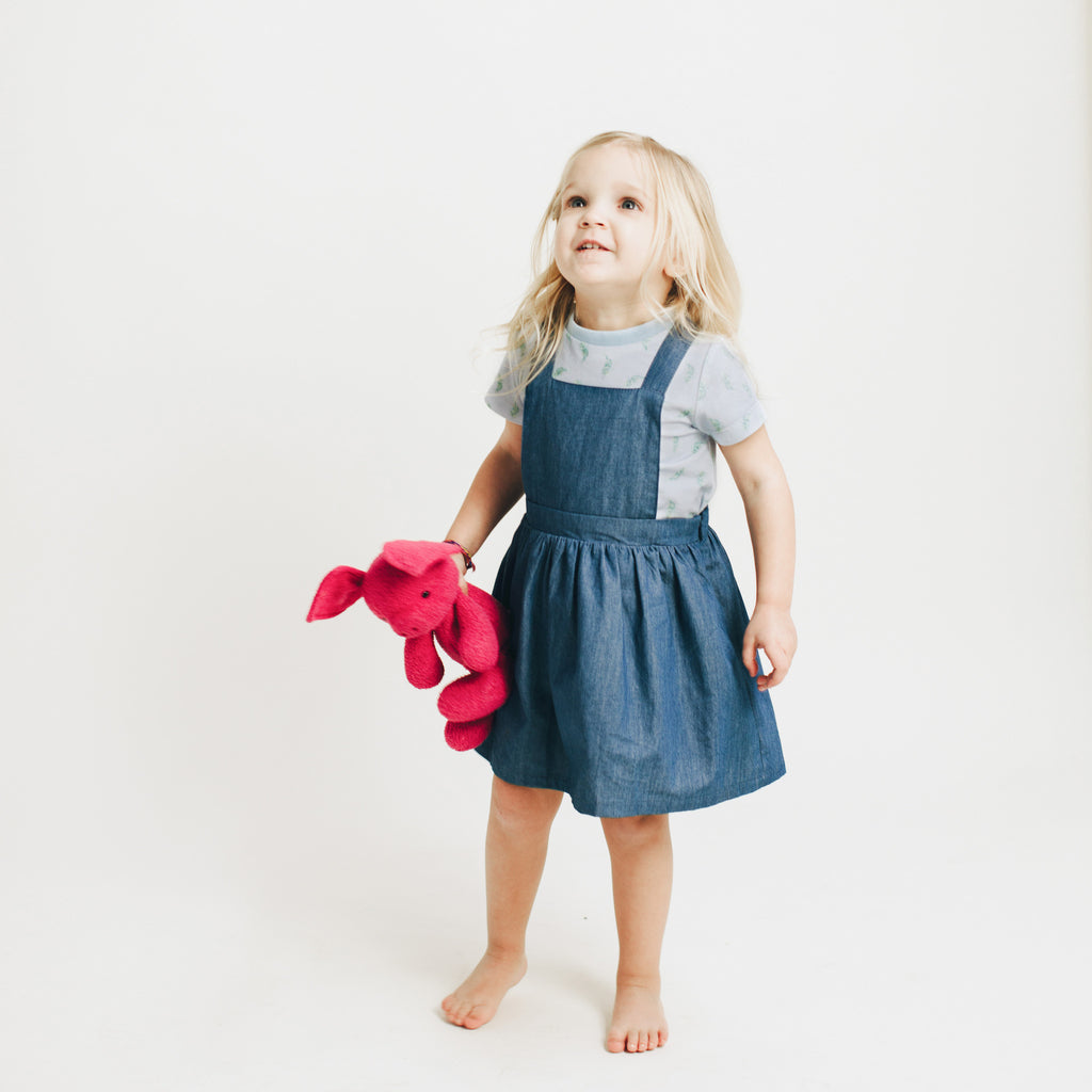 Girls' chambray jumper dress, made to match with Mommy & me, Daddy & me, as well as siblings' chambray shirts. Dress can be worn with any printed tees from our print collections.