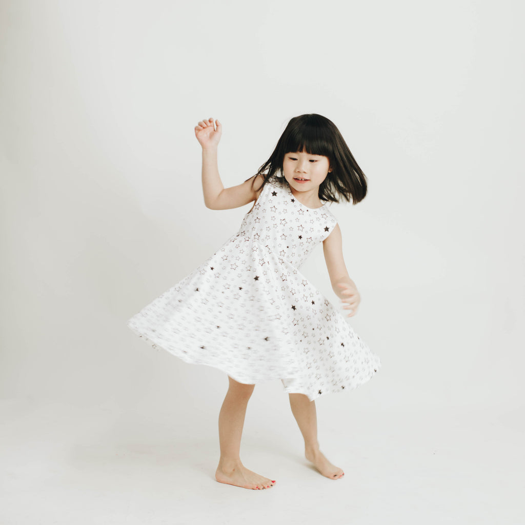 Girls' knit swirl dress in Starry print, to match with Mommy & me, daddy & me tees, and siblings' long johns and onesie dress.