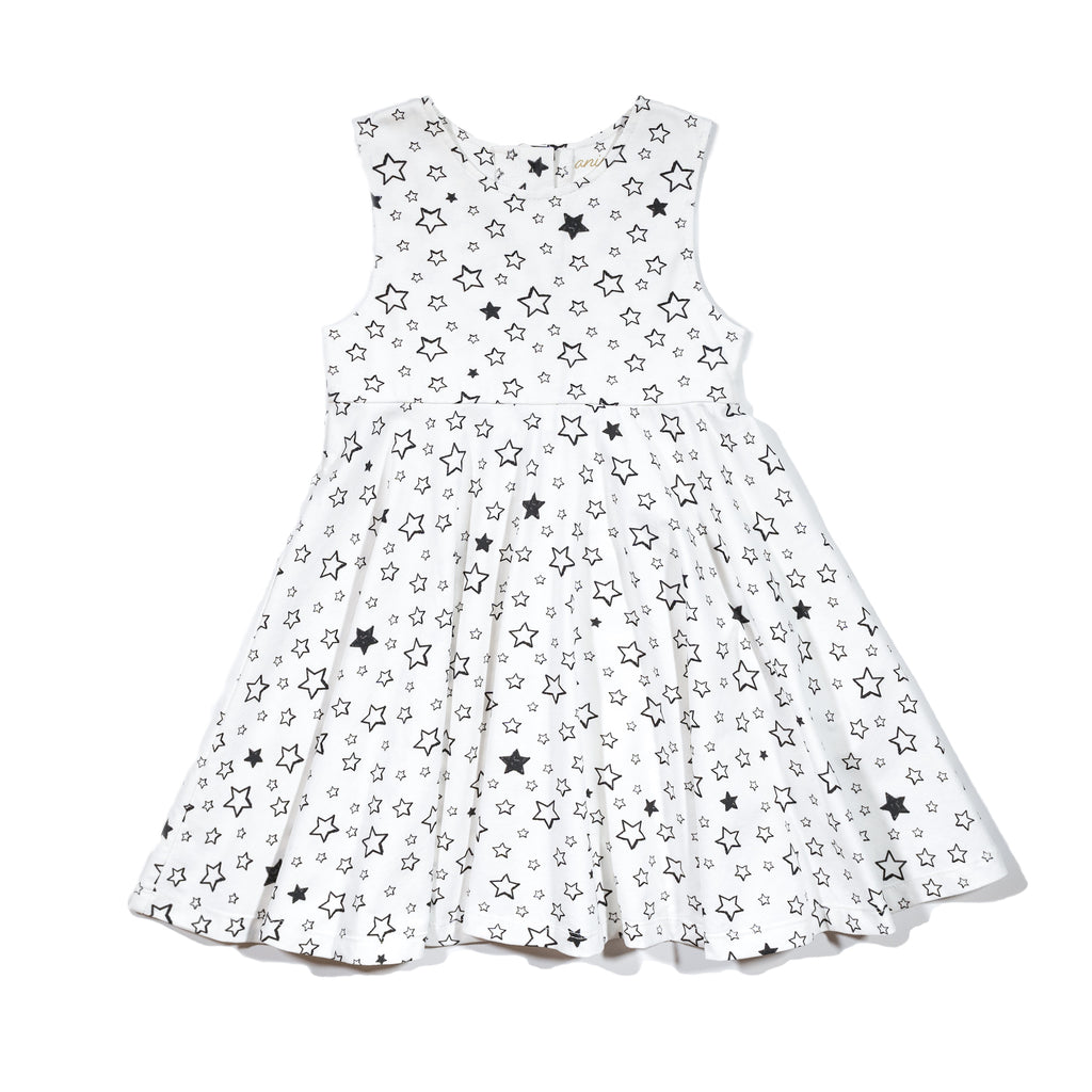 Girls' knit swirl dress front in Starry print, to match with Mommy & me, daddy & me tees, and siblings' long johns and onesie dress.