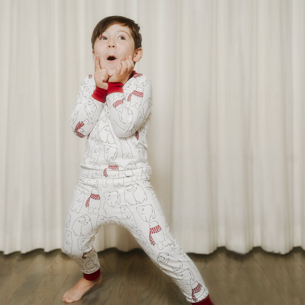 Kids' PJ sets in holiday Cozy Bear print for Mommy & Me, Daddy& Me, and siblings twinning for the perfect holiday family photo.