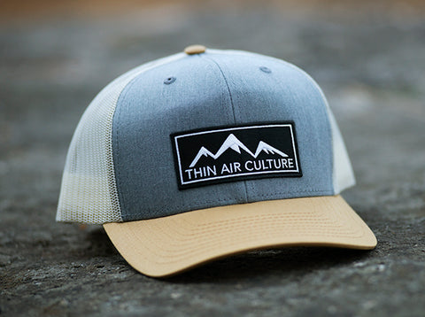 Hat- Cotton twill trucker with pre-curved visor