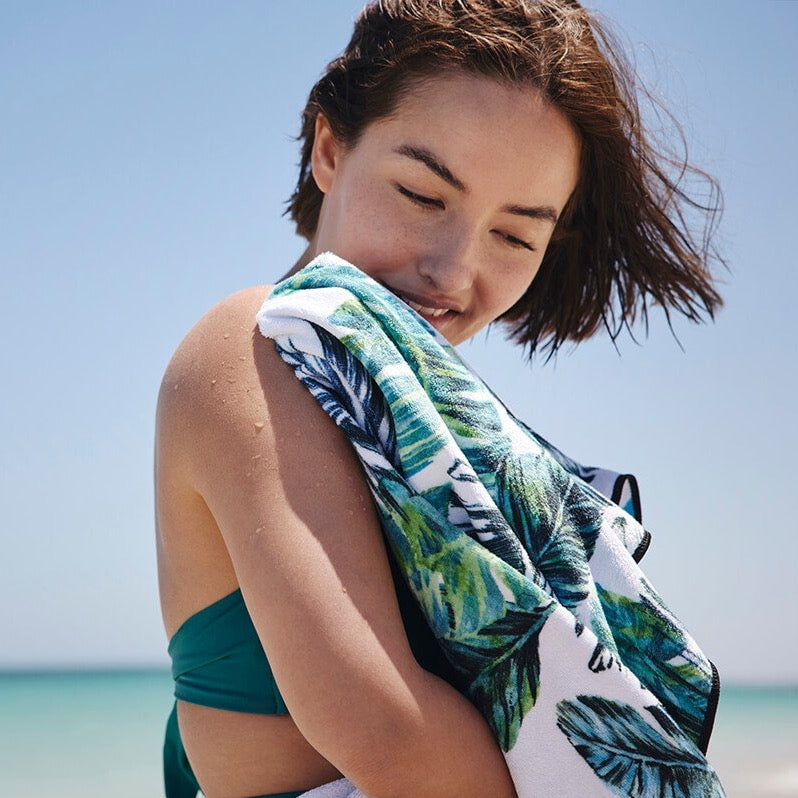 Sand free towel in blue and green feather print