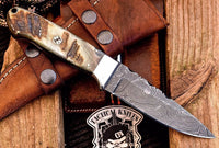 Damascus steel handmade skinning knife