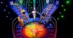 DAve Benson Phillips on Get Your Own Back with contestant hovering above the vat of gunge