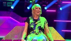 Female contestant covered in green slime