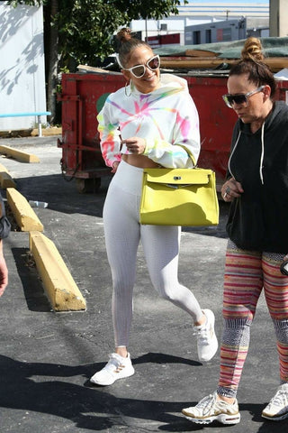 J LO PHOTOGRAphed in a tie-dye sweatshirt and white leggings