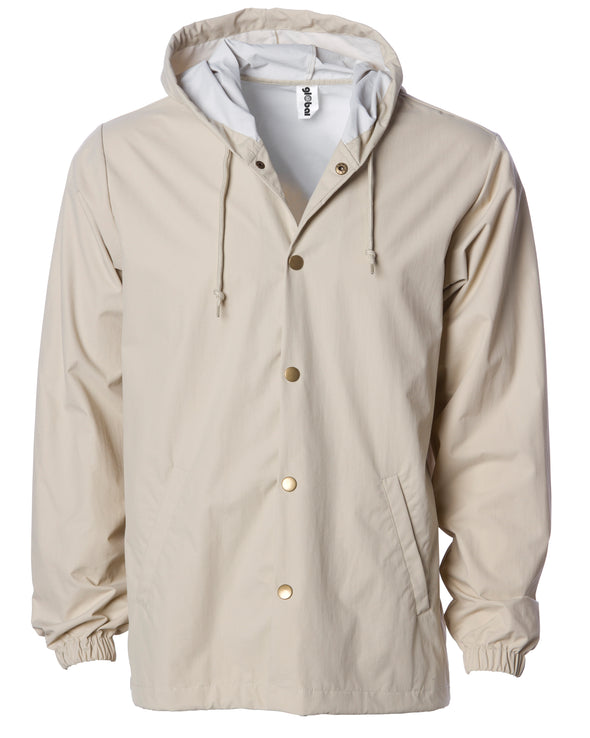 Front of a khaki nylon coach's jacket with gold buttons and a hood.