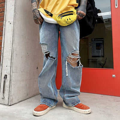 Oversized ripped hole straight fit bleached jeans in blue