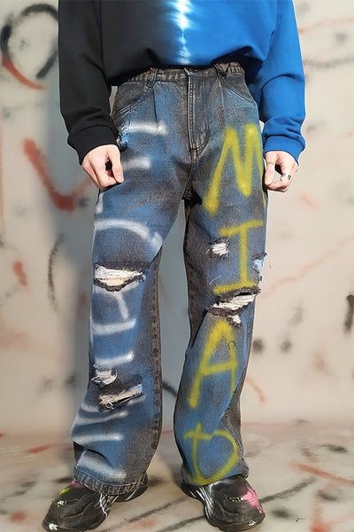 Dark black inkjet letter graffiti print distressed hole ripped washed out loose fit jeans