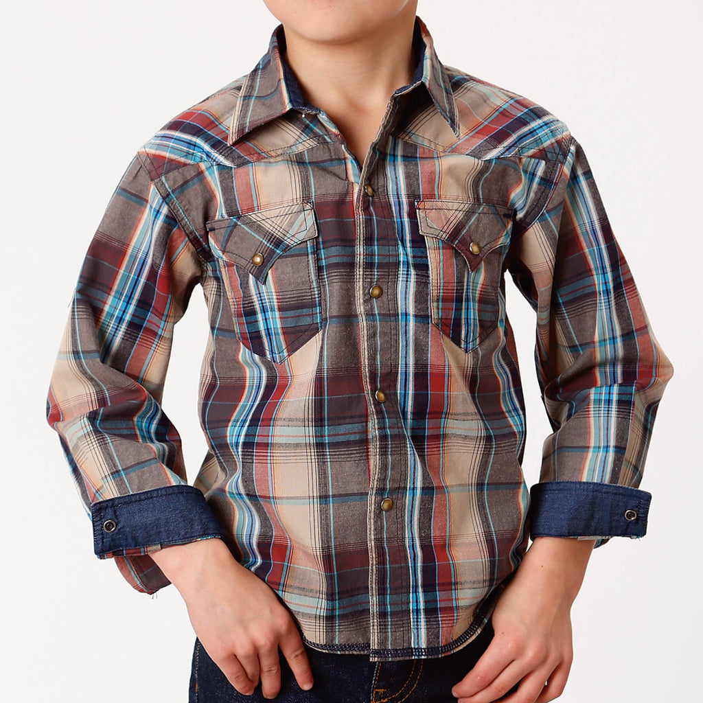 A kids western snap shirt made by Roper western wear.