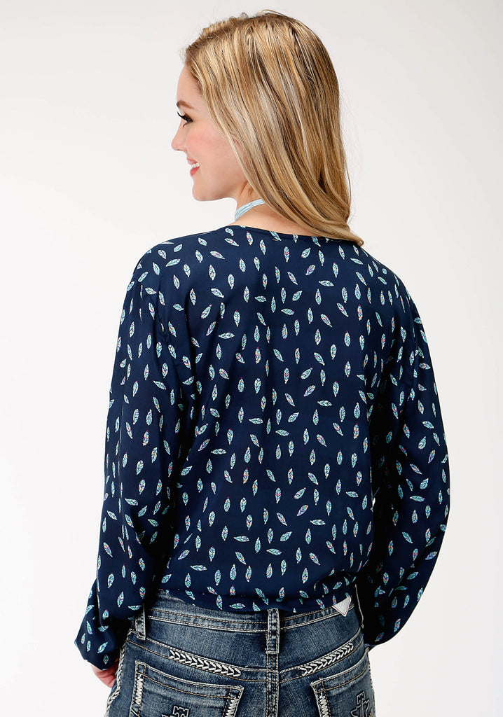 A feather printed blouse made by Roper. A western wear top for women.