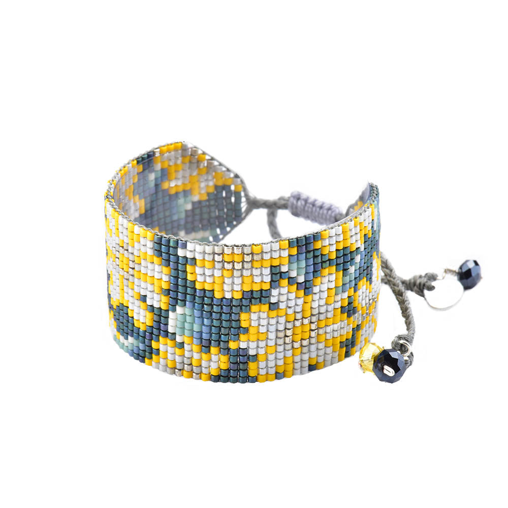 This beautiful bracelet is handcrafted with glass beads. The bracelet features an adjustable strap, allowing for a tighter or looser fit. Made by Mishky. BE-M-7597