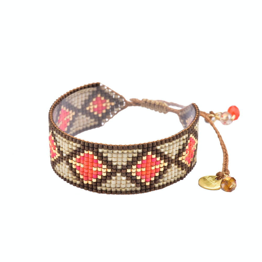 This beautiful bracelet is handcrafted with glass beads. The bracelet features an adjustable strap, allowing for a tighter or looser fit. Made by Mishky. BE-S-7809