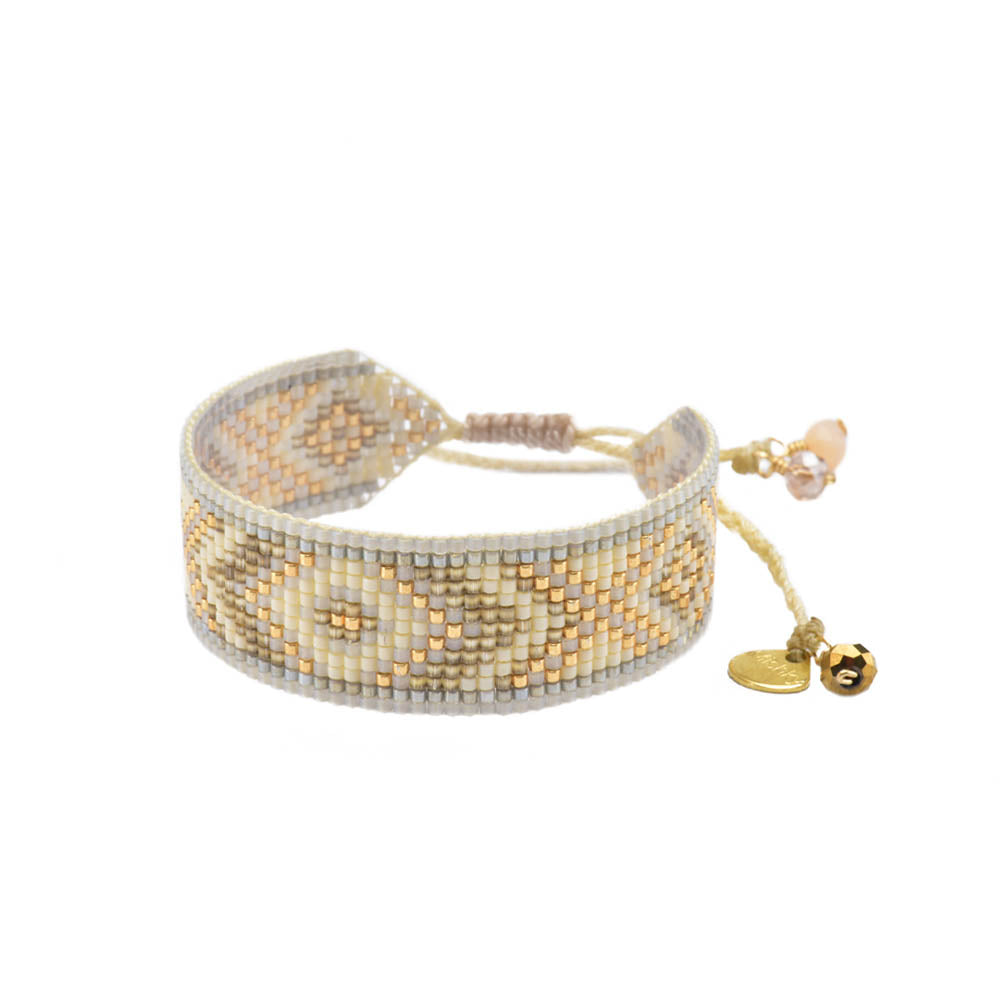 This beautiful bracelet is handcrafted with glass beads. The bracelet features an adjustable strap, allowing for a tighter or looser fit. Made by Mishky. BE-S-7811