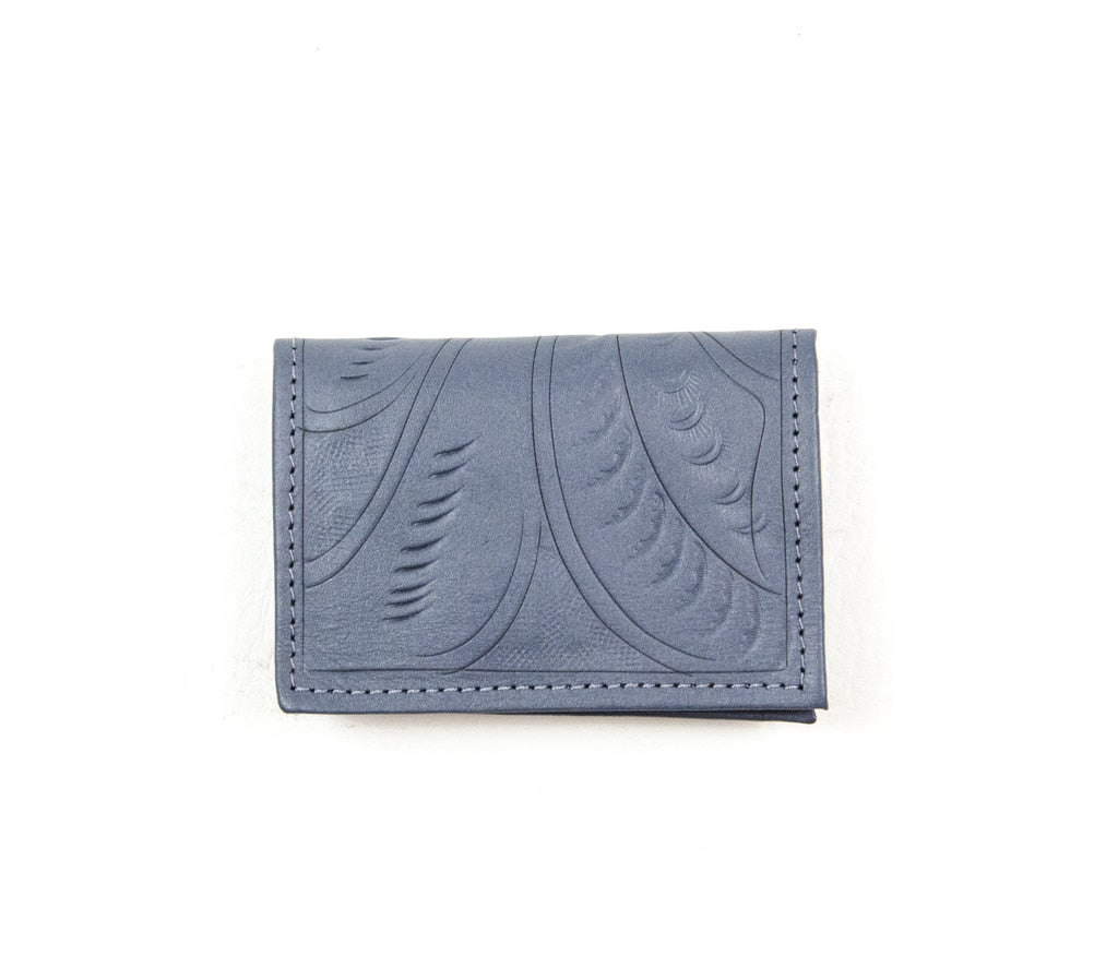 This beautiful tooled leather business card holder comes in a beautiful gray matte color at Head West in Bozeman, Montana.