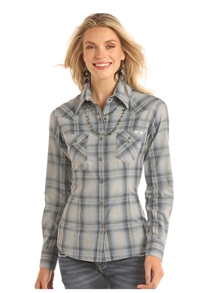 A women's plaid shirt designed by Powder River Outfitters and colored in a light blue/grey.
