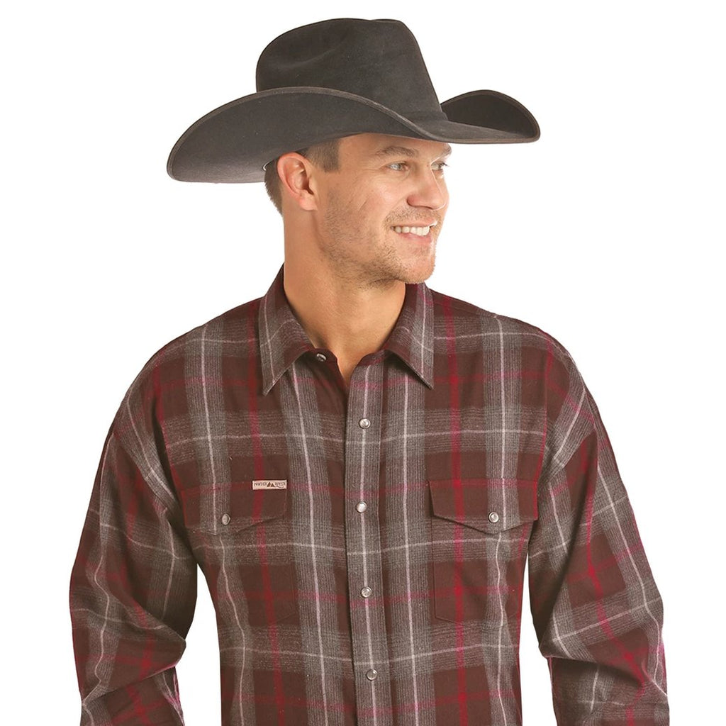 A Poplin red/grey plaid shirt for men made by Powder River Outfitters.