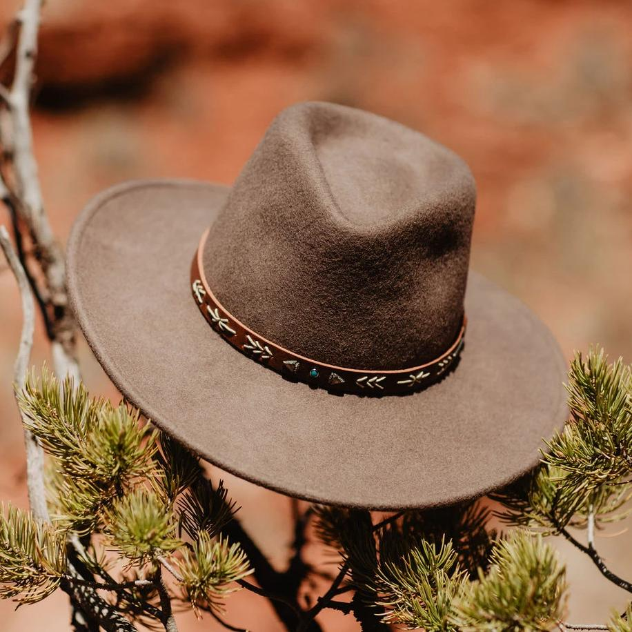 The Santa Fe Outdoor Hat is constructed of crushable wool felt and features a pinch front crown, interior dri-lex sweatband and studded leather hat band. A wool felt cowboy hat. Made in USA.