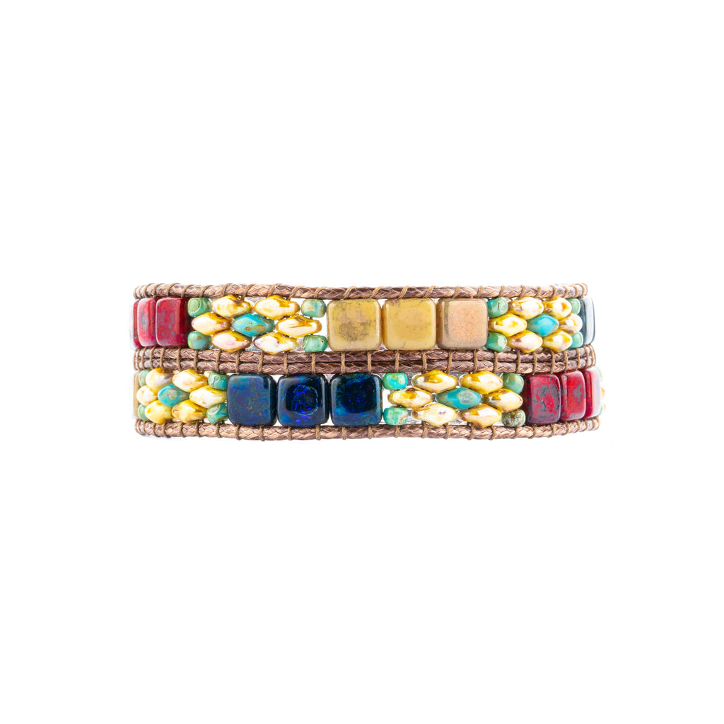 A Lilybead handwoven red and navy beaded bracelet. Find the perfect gift at Head West!