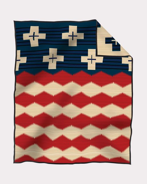 This Pendleton blanket reflects the American flag and the celebration of patriotism of Native Americans. Find your western decor blanket at Head West in Bozeman, Montana.