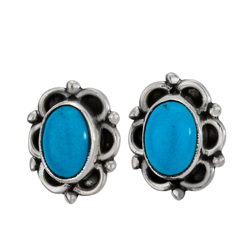 This beautiful pair of earrings are made with sterling silver and styled with vibrant turquoise.