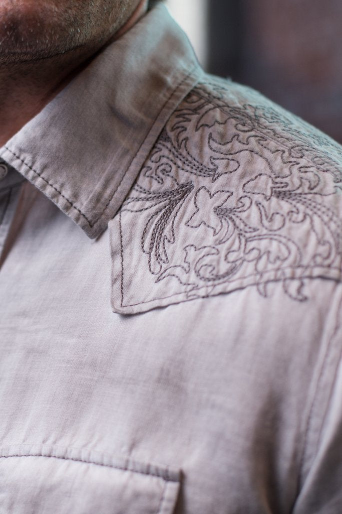 This Ryan Michael snap shirt is features contrast stitching, silver snaps, embroidered details, and more.