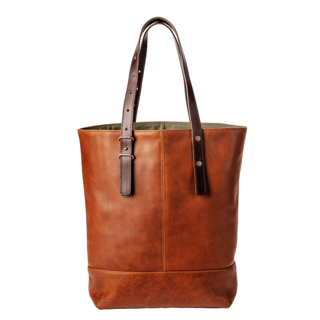 This leather tote made by Pendleton features a roomy interior with zip pocket and cotton lining.