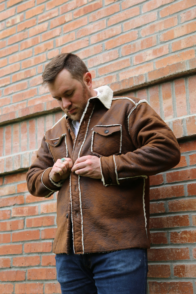 A vintage bonded leather button jacket made by True Grit. Western jacket at Head West western boutique in downtown Bozeman, Montana.