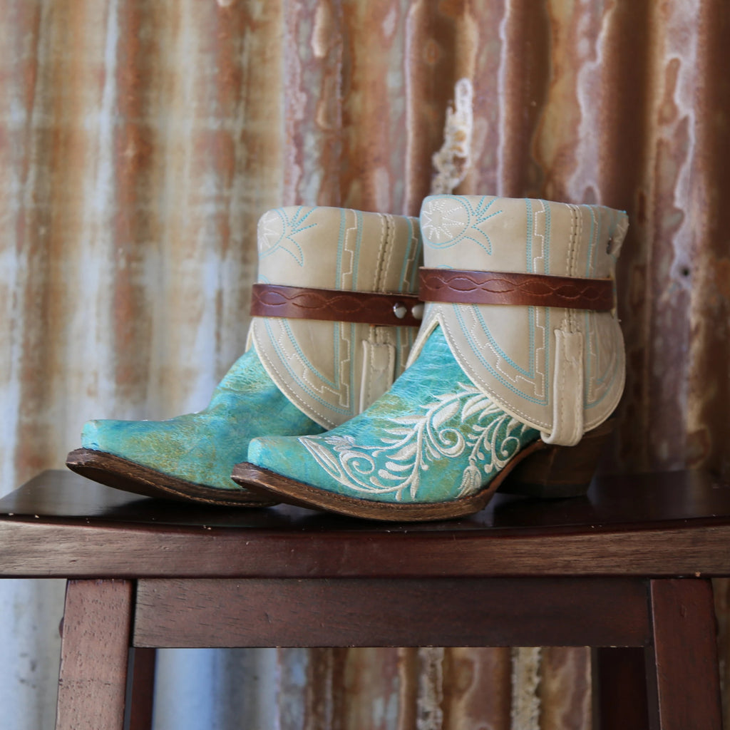 A Canty boot with turquoise floral embroidery along the side.