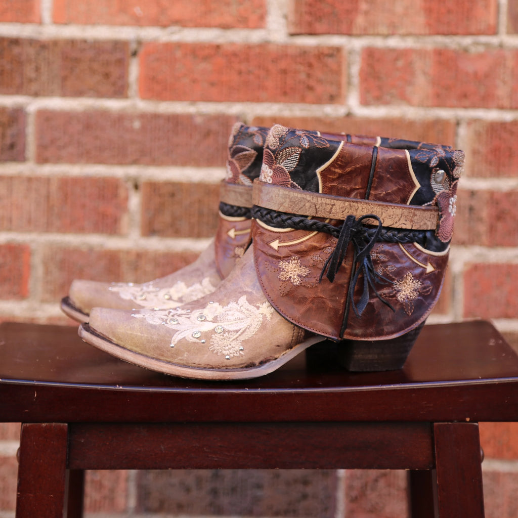 A pair of cowgirl boots made into Canty Boots.