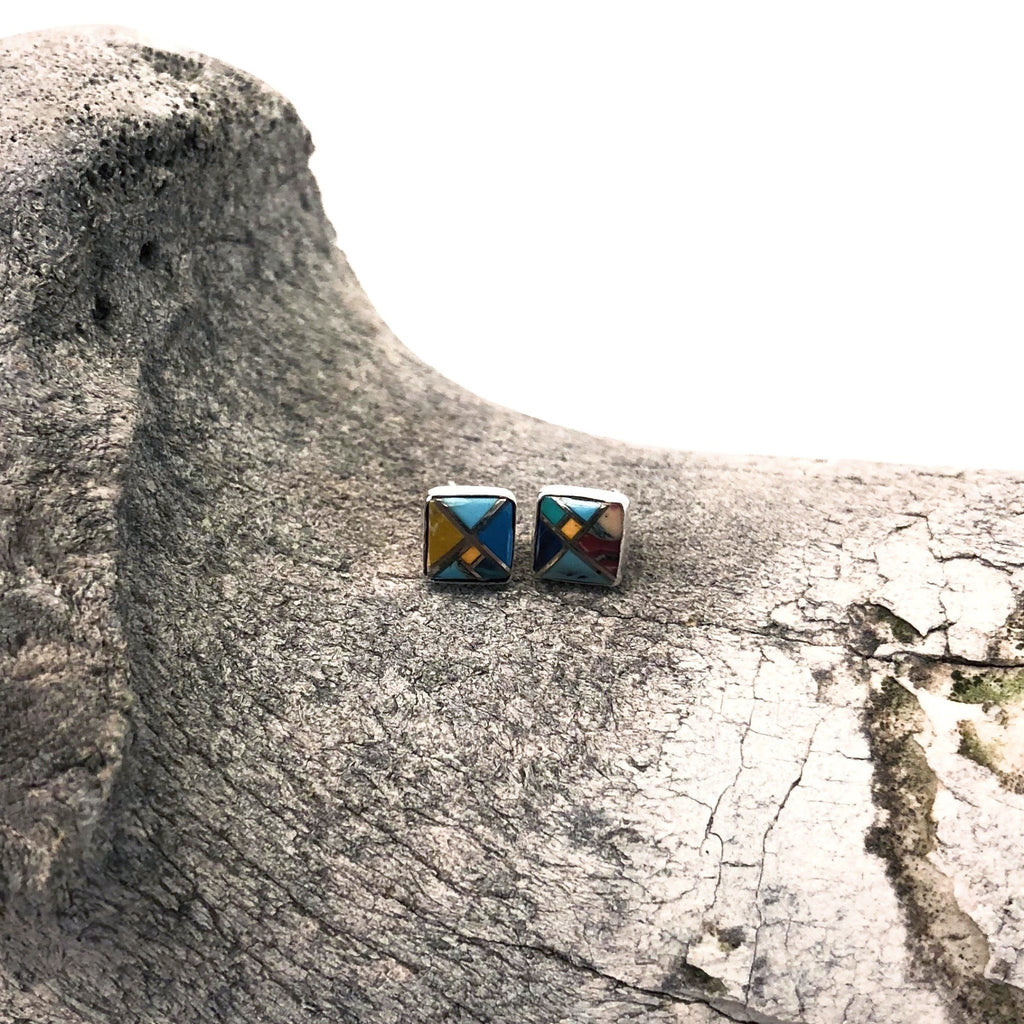 Hand crafted with sterling silver by Paige Wallace, these beautiful earrings feature a unique square design. Colored in various shades of turquoise, yellow, red, blues, blacks, and more colors, these earrings pair with any outfit and are fit for any occasion!