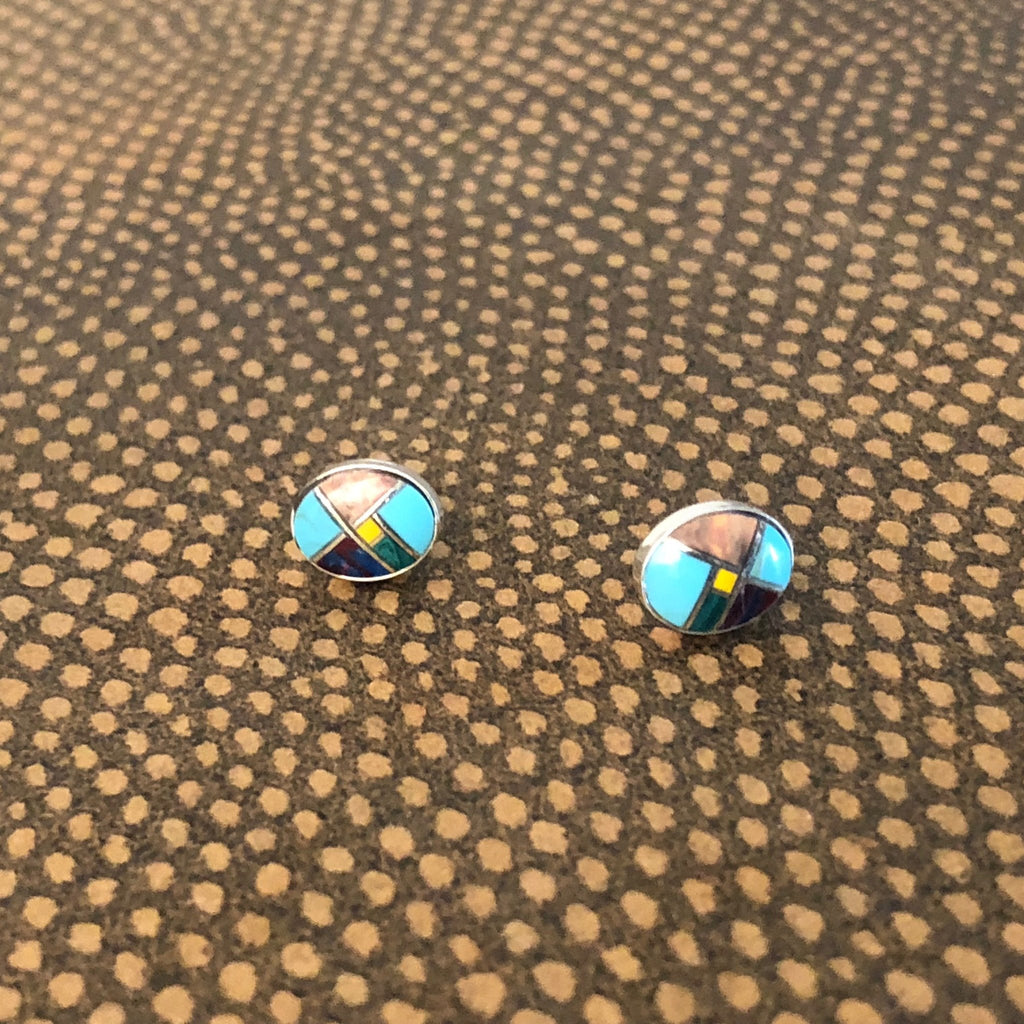 This beautiful pair of oval inlay studs are made by Paige Wallace in Texas. The earrings feature turquoise and other various stones in Sterling Silver.
